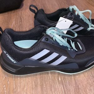 Black and blue running/track shoes